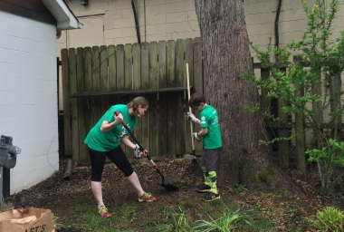 Comcast Employee Kim Sasser Hayden and her son help spruce up the JL Clay Center for the 15th Comcast Cares Day volunteer project in Franklin